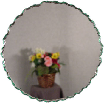 Round frameless chipped edge mirror